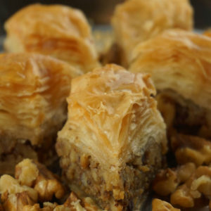 Baklava; made with filo pastry, honey syrup, and nuts is one of Greece's most beloved desserts!